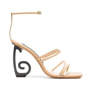 Geometric sandals by Jacquemus.